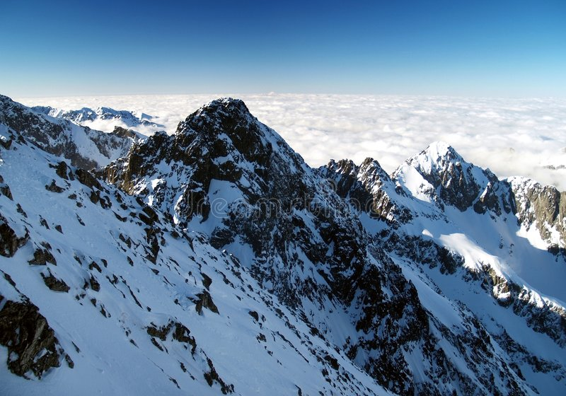 High Tatra mountains in winter. Scenic view of High Tatra mountain peaks in winter with cloudscape background, Slovakia stock image