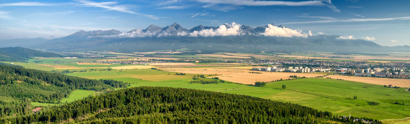 HIgh Tatras mountains and city Poprad, Slovakia. Panorama landscape royalty free stock photo