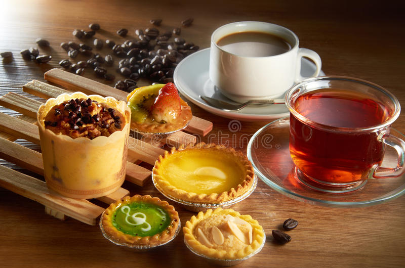 High Tea. With pastry and coffee beans background stock images