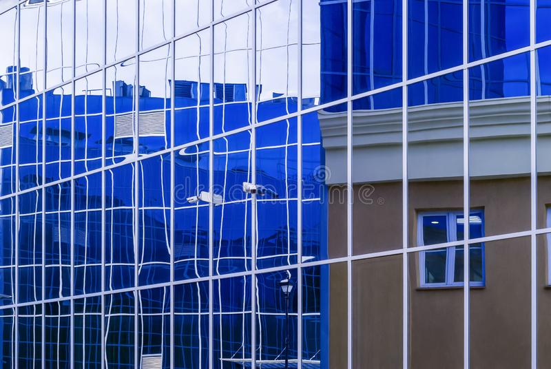 High-tech citysсape, fragment of glass and metal building facades. Perm, Russia - May 26, 2019: high-tech style citysсape, fragment of glass and metal royalty free stock photo