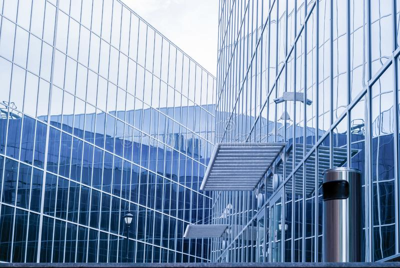 High-tech cityscape, fragment of glass and metal building facades. High-tech style cityscape, fragment of glass and metal building facades royalty free stock photos