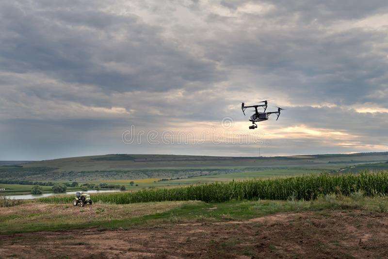 High technological innovation to improve productivity in agriculture. A drone flies over the farmer`s field. royalty free stock photography