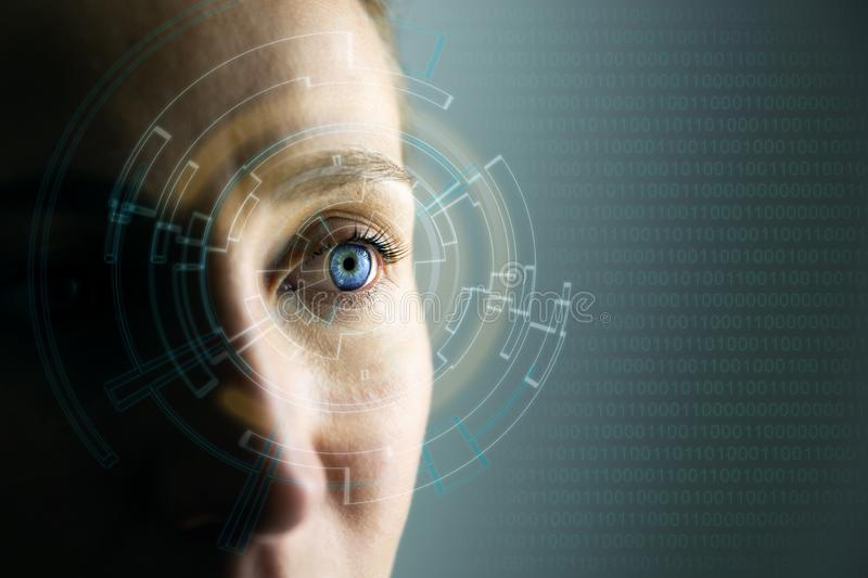 High Technologies in the future. Young woman`s eye and high-tech concept, augmented reality display, wearable computing stock image