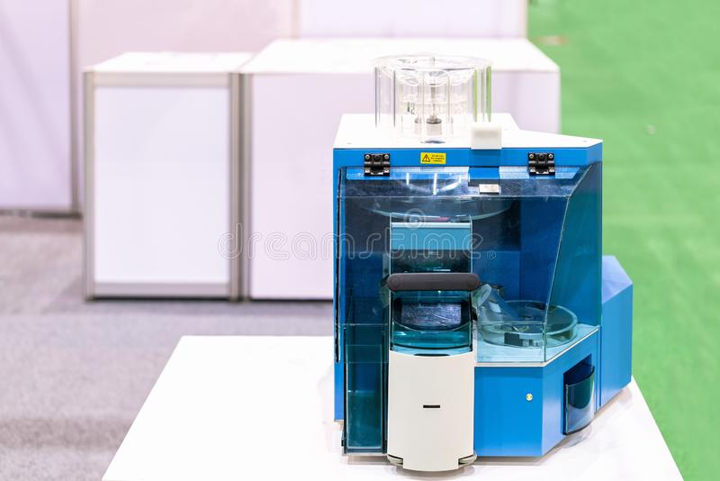 High technology and fully automated tablet handling device of lab for measuring such as weight size hardness quantity thickness. For industrial chemical royalty free stock photography