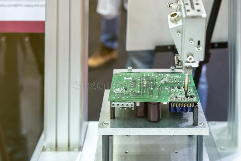 High technology and modern automatic robot for pcb print circuit board assembly machine during soldering or welding part or. Component royalty free stock image