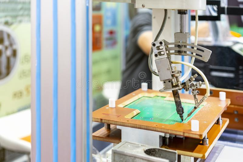 High technology and modern automatic robot for pcb print circuit board assembly machine during soldering or welding part or. Component royalty free stock photos