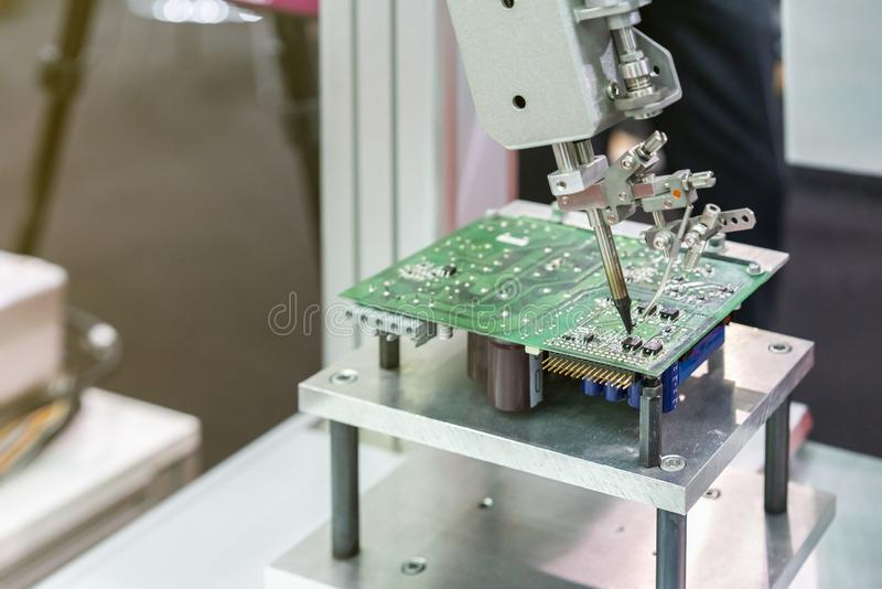 High technology and modern automatic robot for pcb print circuit board assembly machine during soldering or welding part or. Component stock photo