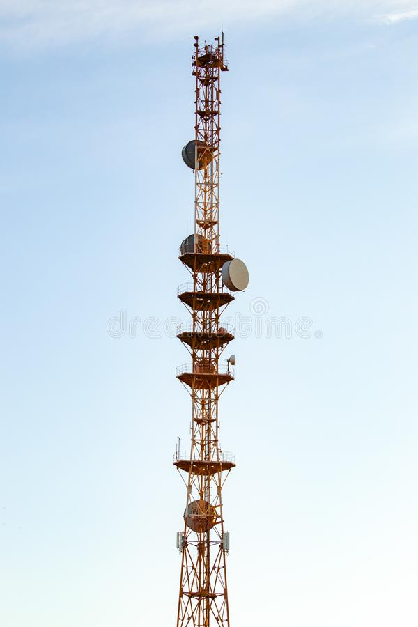 High telecommunication cell tower. Bottom view royalty free stock image