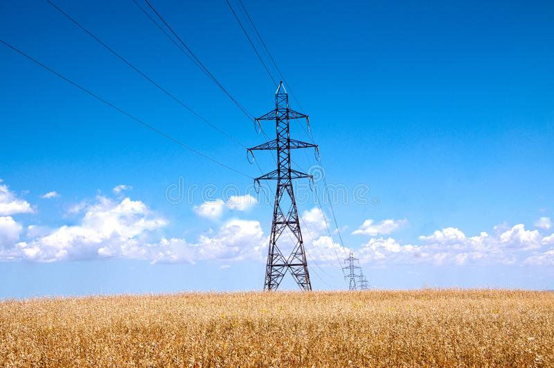 High Tension Line on a summer field stock images