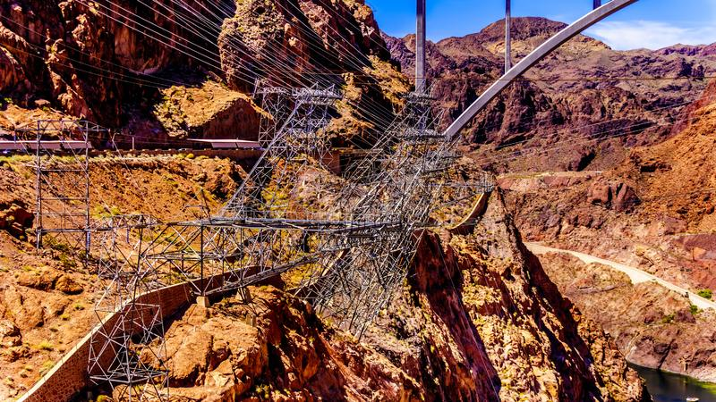 The High Tension Power Lines and supporting Towers on the Walls of Black Canyon at the Hoover Dam royalty free stock photo