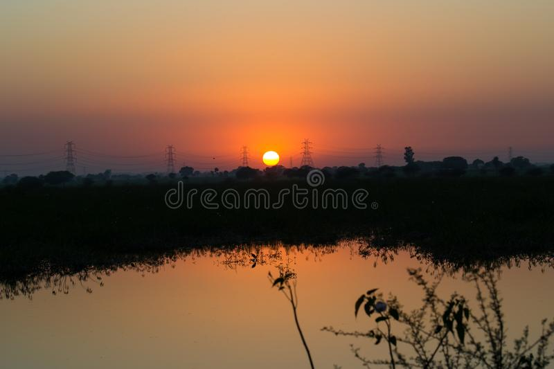 High Tension Electricity Power Lines and Sunset stock photos