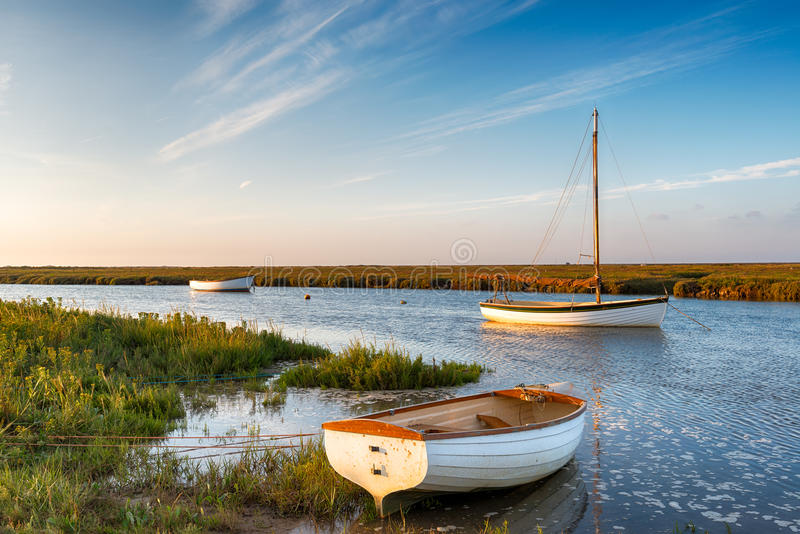 High Tide at Blakeney. Boats at high tide on salt marshes at Blakeney on the north Norfolk coast royalty free stock image