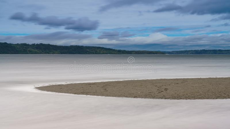 High Tide Rising Along Puget Sound Tacoma. Long Exposure of High Tide On Puget Sound On Cloudy Day royalty free stock photos