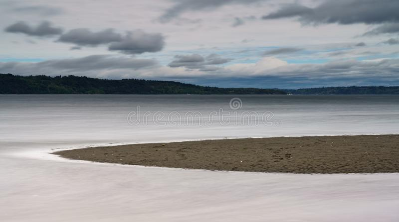 High Tide Rising Along Puget Sound Tacoma. Long Exposure of High Tide On Puget Sound On Cloudy Day stock photo