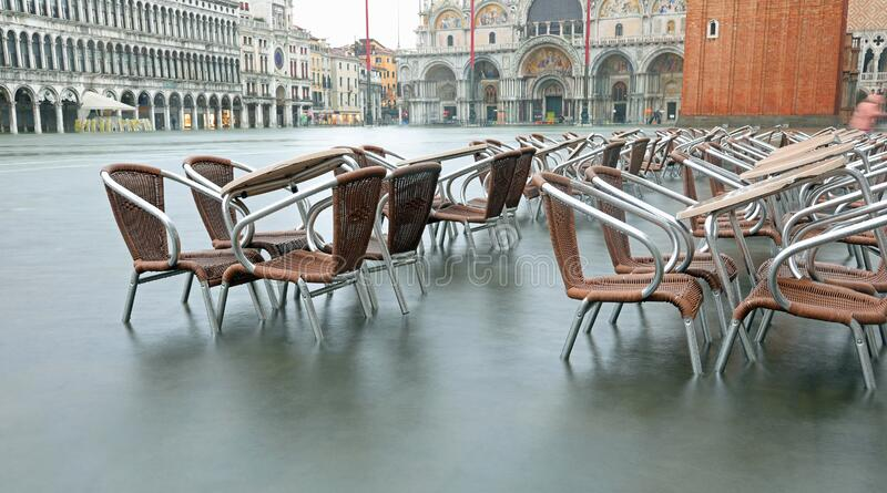 High tide in Venice Island and the chairs and tables royalty free stock images