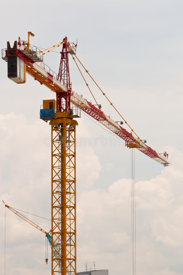 A High Tower Crane. A Portrait of Tower Cranes Soaring up the Sky Ready for Lifting stock photo