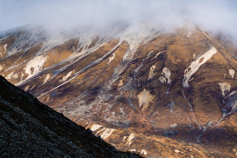 High view brown mountain layer with mist. On top frame stock image