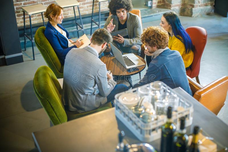 High view of colleagues working and talking at shop table.Group of multiethnic people having business team meeting in royalty free stock photos