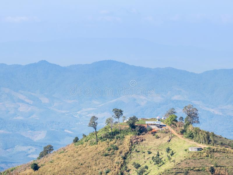 High view of deforestation for farming on slope of rainforest mountain. With blue sky stock photos