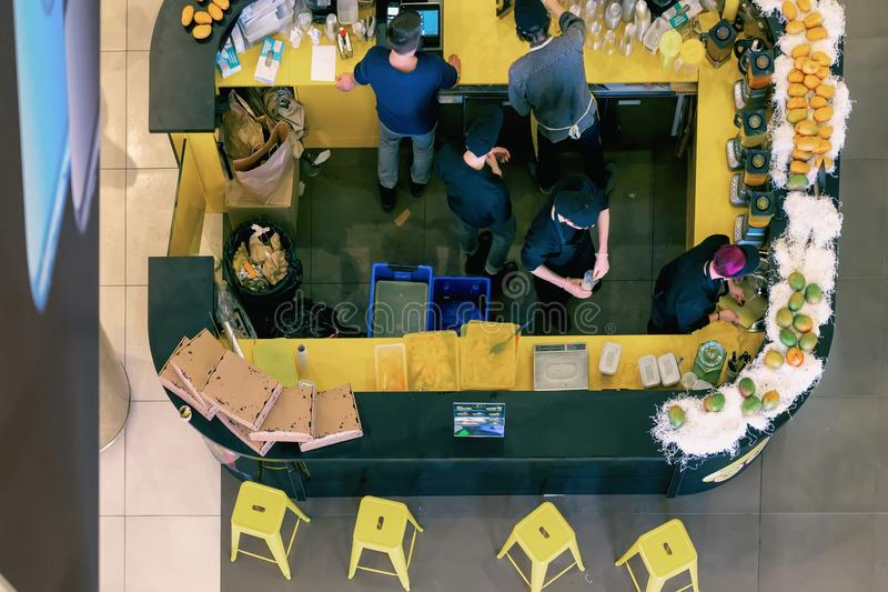 High viewing angle, cafe bar, sale of fresh juices, unrecognizable sellers. View from above royalty free stock photos
