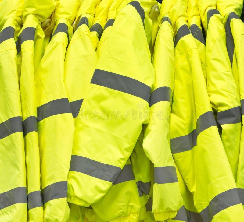 High visibility jackets. Bright yellow high visibilty jackets royalty free stock image