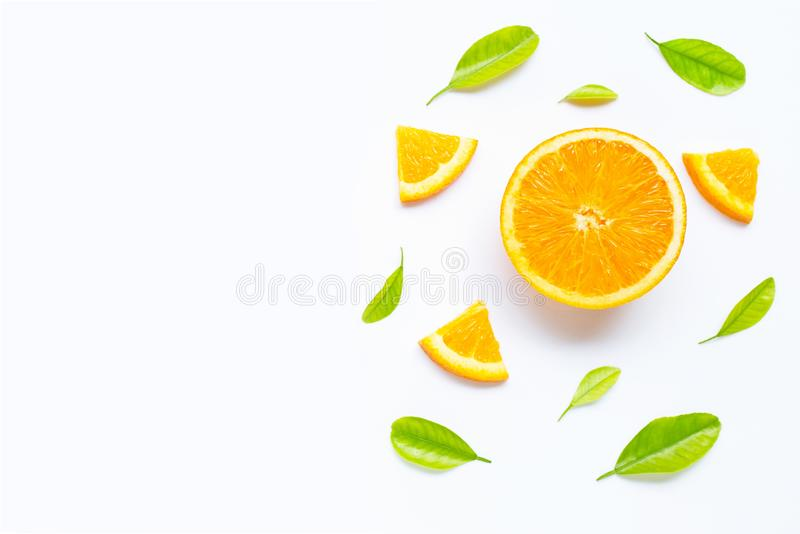 High vitamin C, Juicy and sweet. Fresh orange fruit with green leaves  on white royalty free stock photos