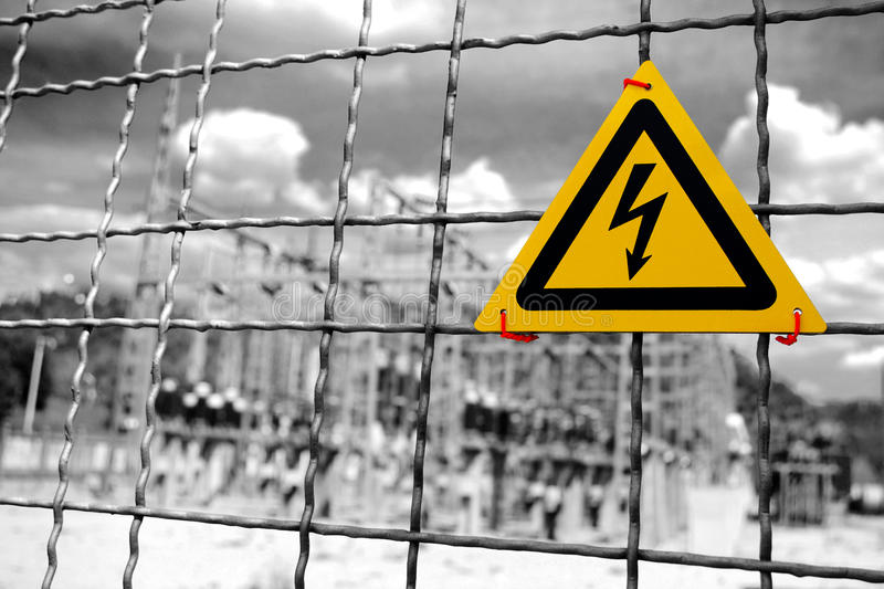 High Voltage. Electrical power plant with High Voltage sign in a fence royalty free stock photo