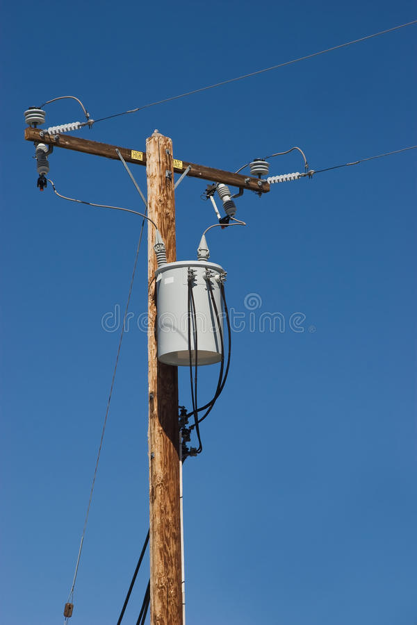 High Voltage. Utility pole with has a transformer in a suburban area stock images