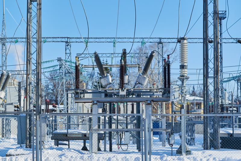High-voltage circuit breakers at electrical substations connected with wires. stock images