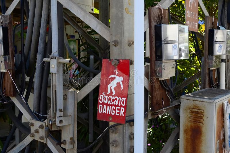 High voltage danger sign in Laos royalty free stock images