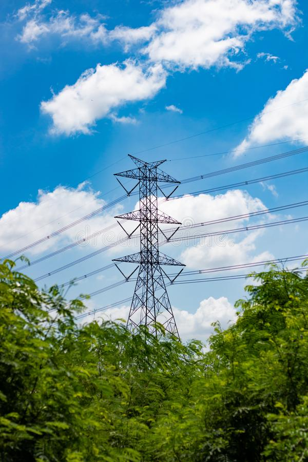 High voltage electric pole on sky background. View of High voltage electric pole on blue sky background stock photo