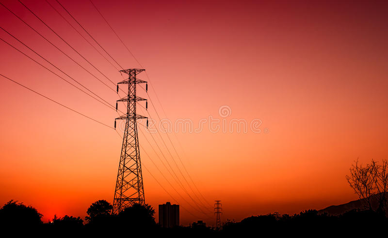 High voltage electric pole sunset royalty free stock image