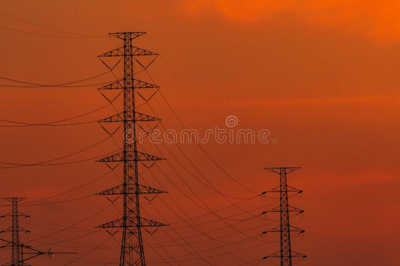 High voltage electric pole and transmission lines in the evening. Electricity pylons at sunset. Power and energy. Energy royalty free stock photography