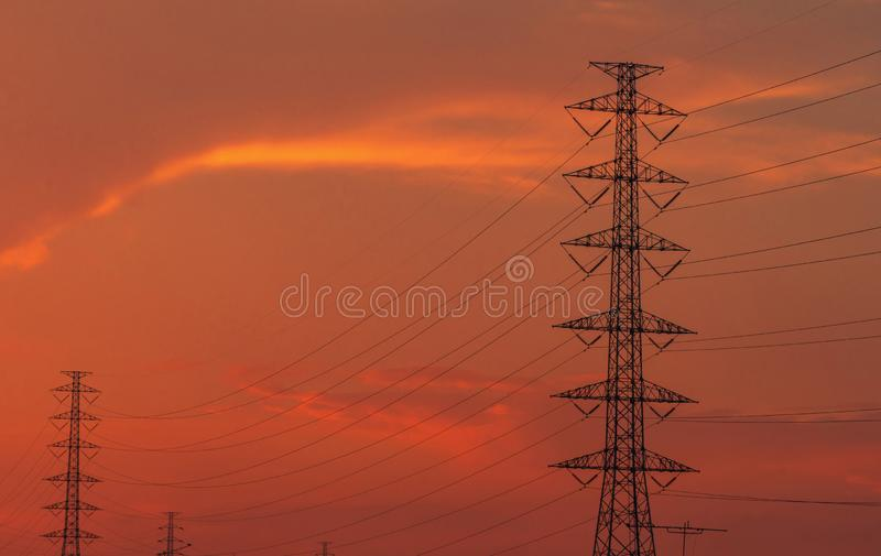 High voltage electric pole and transmission lines in the evening. Electricity pylons at sunset. Power and energy. Energy royalty free stock photo