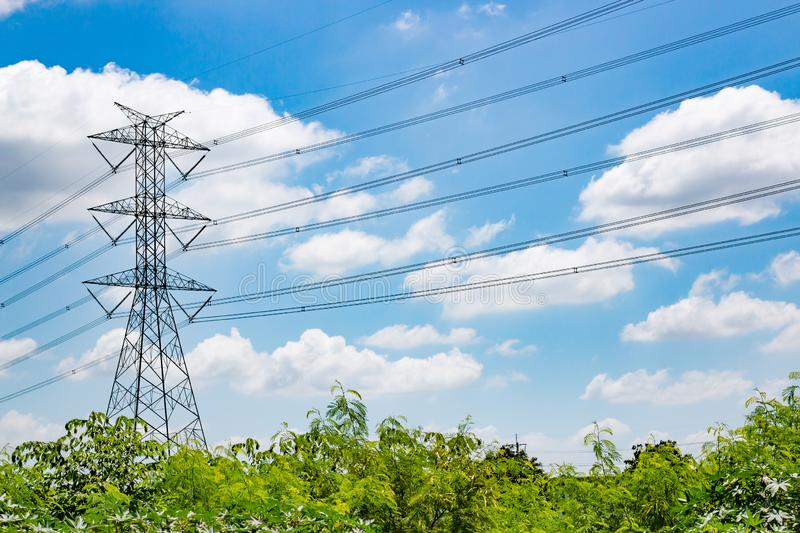 High voltage electric pole. View of High voltage electric pole on blue sky background royalty free stock image