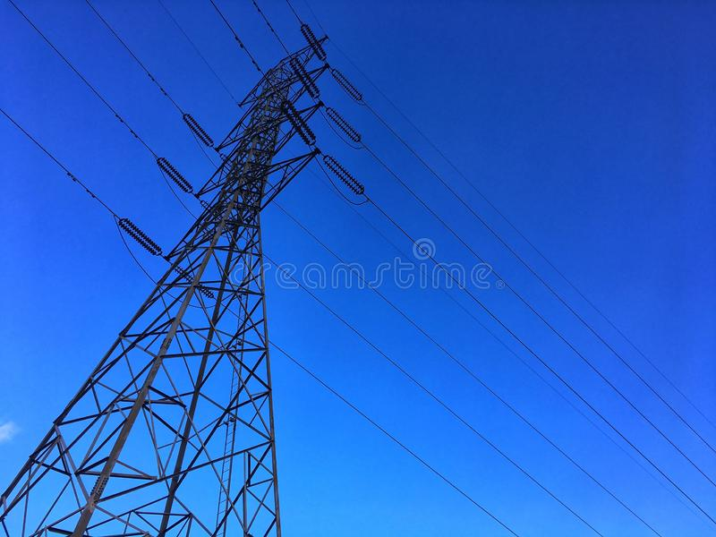 High voltage electric power pole from bottom view. royalty free stock photos