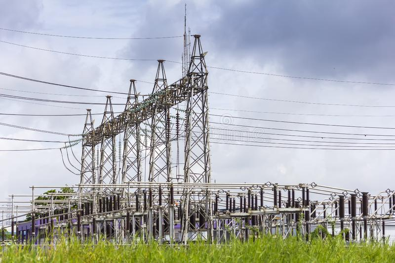 High voltage electric power substation with cloudy dark sky background.  royalty free stock images