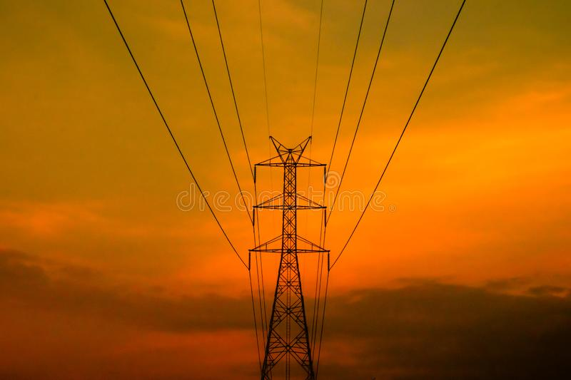 High voltage electric pylon with sunset sky. royalty free stock photos