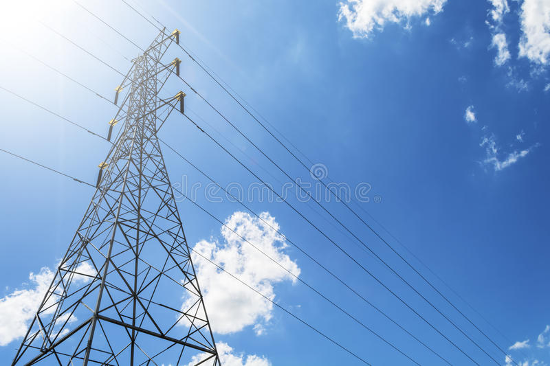 High Voltage Electric Transmission Tower Energy Pylon against th stock photo