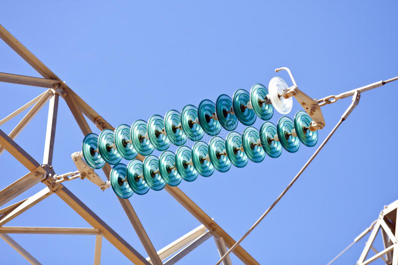 High-voltage electrical insulator electric line. Against the dark blue sky stock image