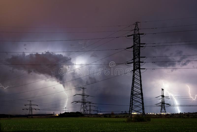 High voltage electrical mast with lightning storm over Prague, Czech republic. Silhouette of high voltage electrical mast with lightning storm over Prague, Czech stock photography