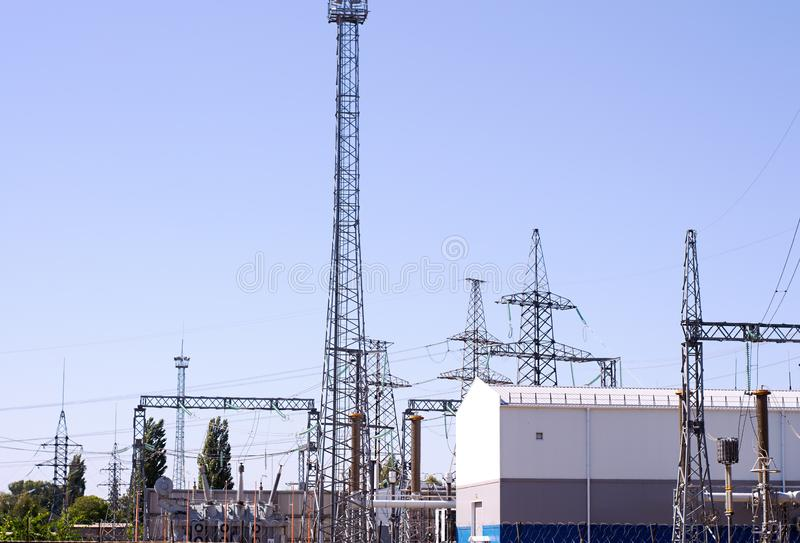 High voltage electrical substation with transformers and electric towers. High voltage electrical substation with transformers and electric towers royalty free stock image