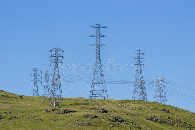 High voltage electricity towers on a blue sky background, California stock photography