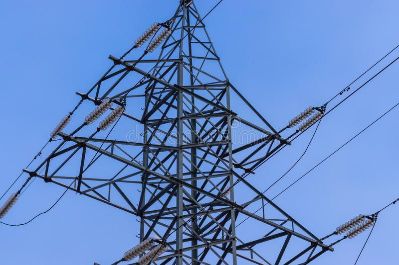 High-voltage electricity transmission line. Power line support against the blue sky royalty free stock image