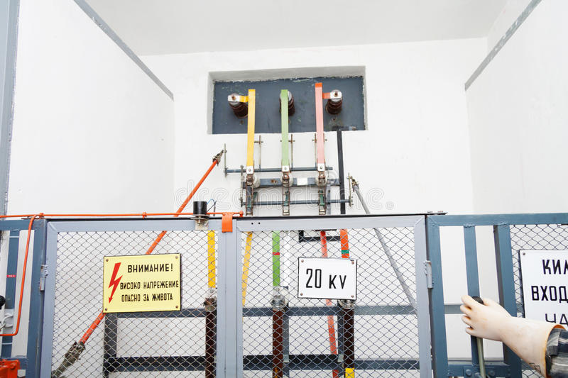 High voltage equipement with a fence, warning signs and hand royalty free stock image