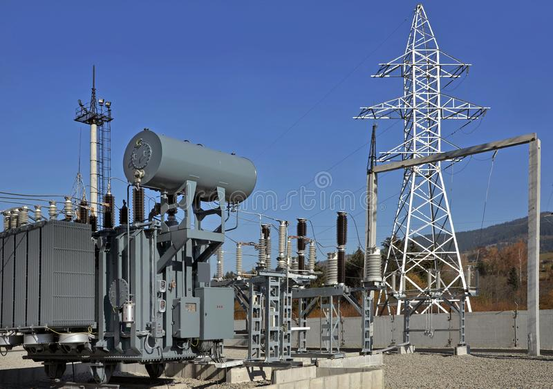 High voltage oil-filled power transformer on electrical substation. royalty free stock photography