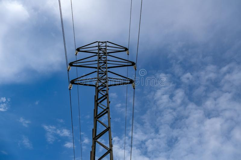 High voltage post or metal tower with electric power transmission line stock photos