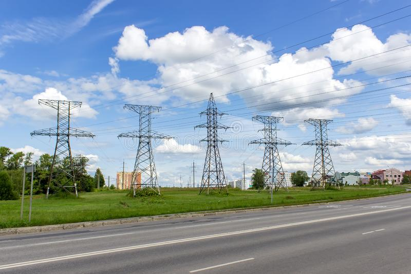 High voltage posts in scenic colourful summer landscape, industrial background royalty free stock photos