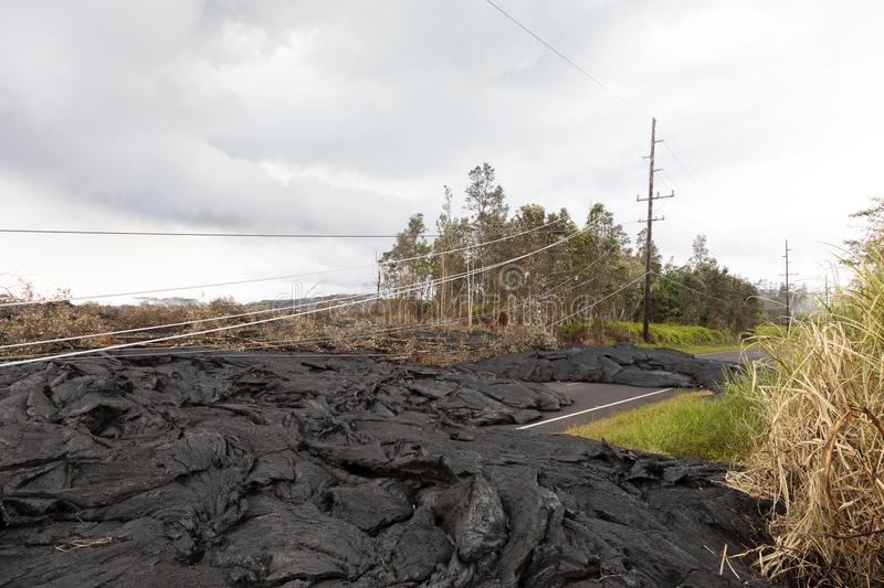 High voltage power line destroyed by a lava flow in Hawaii. May 2018 royalty free stock image