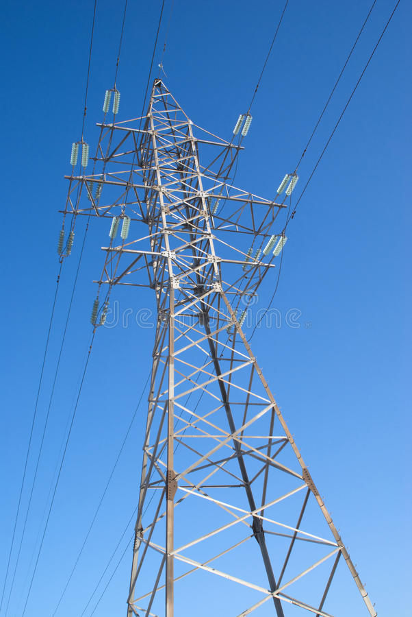High-voltage power line metal prop over blue sky royalty free stock photos